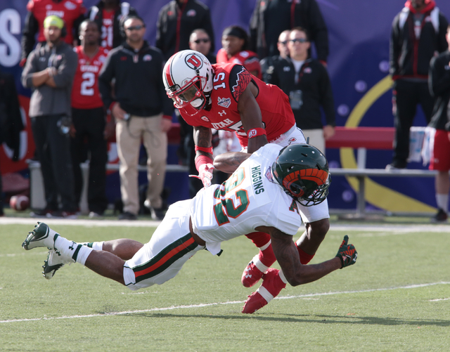 University of Utah's Dominique Hatfield (15) makes a tackle on the ball carrier Colorado State University's Rashard Higgins (82)(WR) during the first half  half of the  Royal Purple Las Vegas Bowl ...