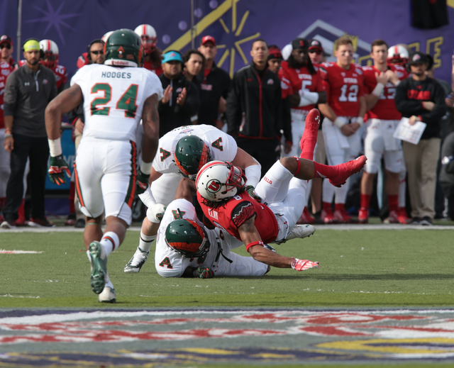 Colorado State University's Dee Hart (10)(RB) and Colorado State University's DeAndre Elliott (13)(DB) make a tackle on ball carrier, Utah's Kaelin Clay during the first half of the  Royal Purple  ...