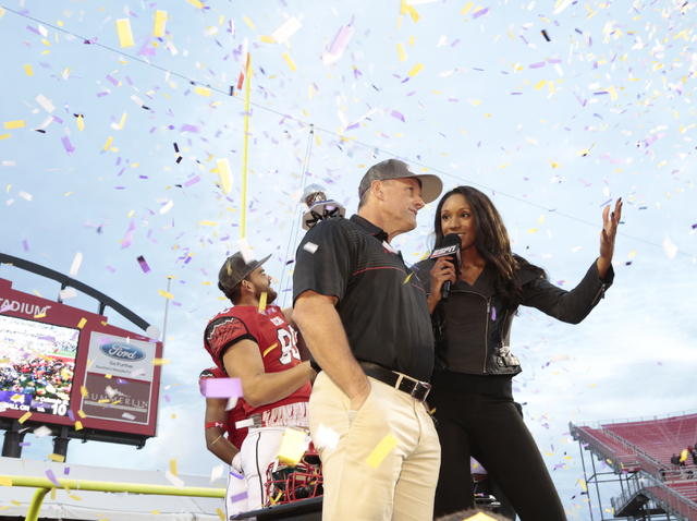 Kyle Whittingham - Head Coach for the University of Utah, speaks with the ESPN reporter during the celebration after winning the  Royal Purple Las Vegas Bowl with a score of 45-10 against the Colo ...
