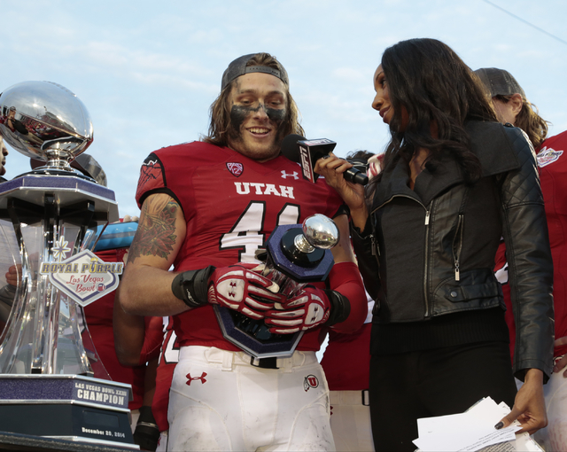 University of Utah's Jared Norris (41)(LB) receives a trophy and is interviews by the ESPN sideline reporter after University of Utah wins the bowl game against Colorado State with a score of 45 t ...
