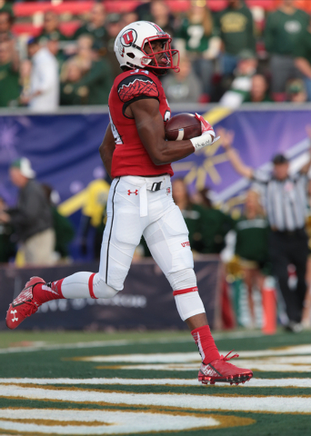 University of Utah's Bubba Poole (34)(RB) runs the ball in for a touchdown during the second half of the  Royal Purple Las Vegas Bowl at Sam Boyd Stadium, Las Vegas, Saturday, Dec. 20, 2014. (Dona ...