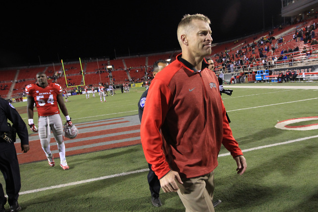UNLV head coach Bobby Hauck leaves the field after the game against Nevada Saturday, Nov. 29, 2014 at Sam Boyd Stadium. Nevada won 49-27. (Sam Morris/Las Vegas Review-Journal)