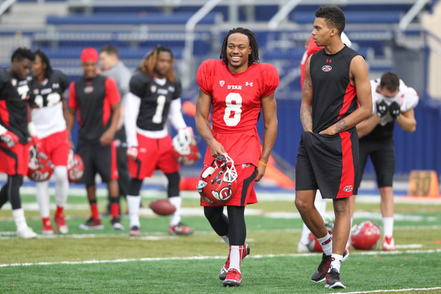 Utah wide receiver Kaelin Clay (8) walks off the field after a team practice at Bishop Gorman Catholic High School in Las Vegas Wednesday, Dec. 17, 2014. Utah will play against Colorado State in t ...