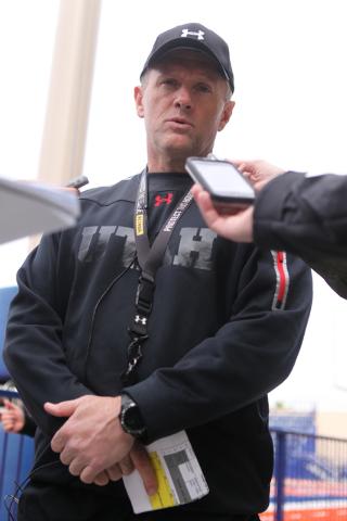 Utah Utes head coach Kyle Whittingham is interviewed during a team practice at Fertitta Field inside Bishop Gorman Catholic High School in Las Vegas Wednesday, Dec. 17, 2014. Utah will play agains ...