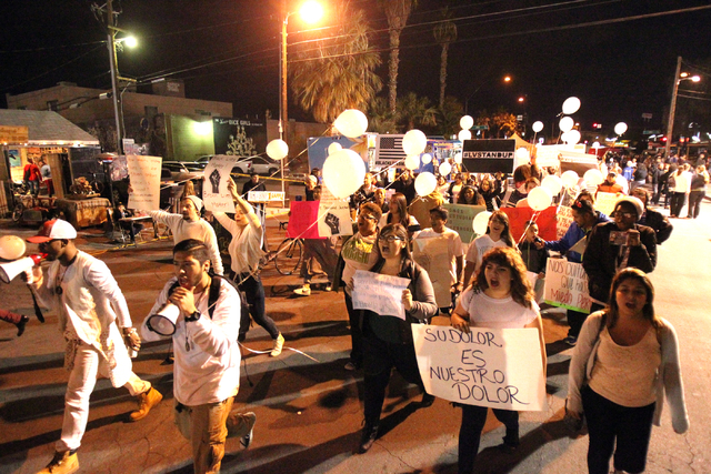 People protesting a officer-involved killings in which law enforcement received no punishment march on Casino Center Drive during the First Friday art event in downtown Las Vegas on Friday, Dec. 5 ...