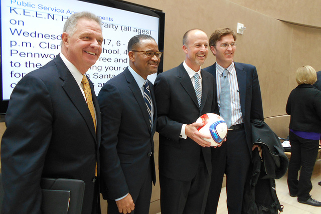 The Findlay-Cordish team celebrates on Thursday, Dec. 17, 2014, after the Las Vegas City Council voted 4-3 to approve a MLS stadium subsidy deal. (Alan Snel/Las Vegas Review-Journal)
