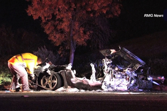Two people survived a serious crash on a Southern California highway Friday night, Nov. 28, 2014. The 2002 Ferrari crashed in Calabasas, California after veering off a road, hitting two trees. (CNN)