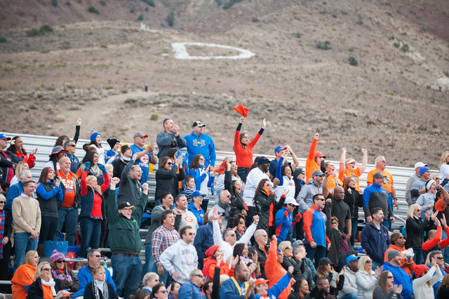 Bishop Gorman fans cheer on their team against Reed during the first half of the NIAA Nevada State High School Division I Championships game at Damonte Ranch High School on Saturday, Dec. 6, 2014  ...