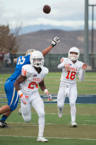 Bishop Gorman's Tate Martell (18) throws a pass down field against the Raiders during the first half of the NIAA Nevada State High School Division I Championships game at Damonte Ranch High School ...