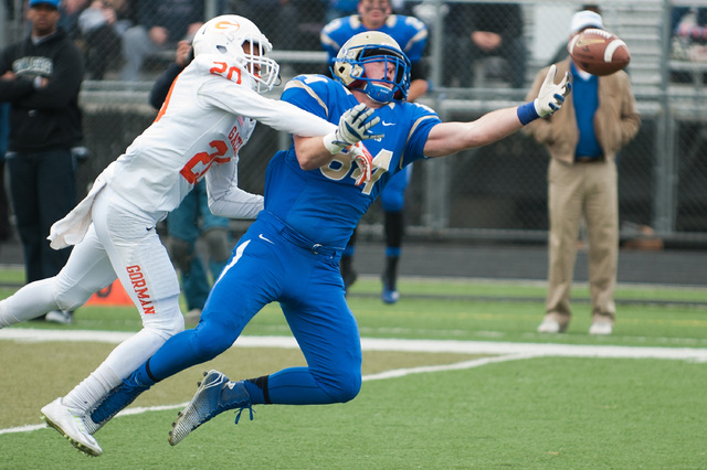 Reed's Parker Houston (84) reaches for a pass against Bishop Gorman's Jabari Butler (20) during the first half of the NIAA Nevada State High School Division I Championships game at Damonte Ranch H ...