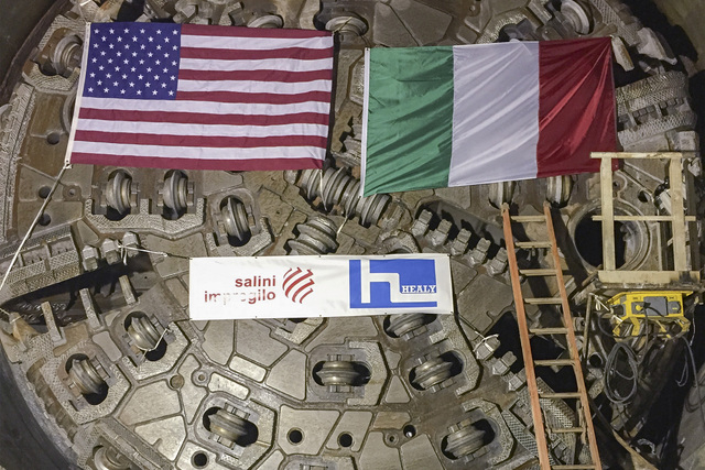 The American and Italian flags hang from the front of a tunneling machine that just finished drilling a three-mile tunnel underneath the bed of Lake Mead and into a water intake structure placed a ...
