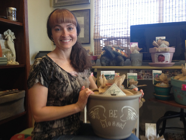 Melissa Santaella poses with a messenger pot at her home in Centennial Hills, Las Vegas, Nov. 21, 2014. Her at home-based business sells pots ranging from $12 to $125 depending on the size, each w ...