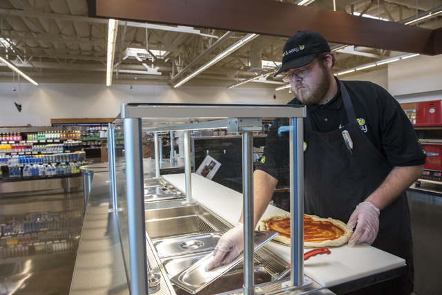 Employee Aaron White makes fresh pizza to give as samples for customers inside the Fresh and Easy supermarket on 4760 W. Cactus Ave. in Las Vegas Friday Dec. 5, 2014. (Martin S. Fuentes/Las Vegas  ...