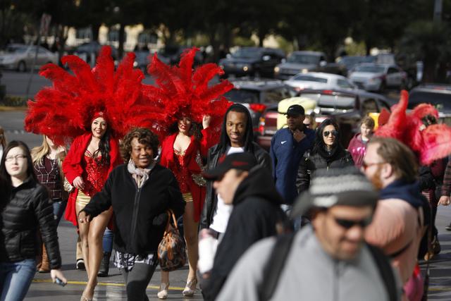 People walk on the sidewalk near Planet Hollywood casino-hotel in Las Vegas Tuesday, Dec. 30, 2014. (Erik Verduzco/Las Vegas Review-Journal)