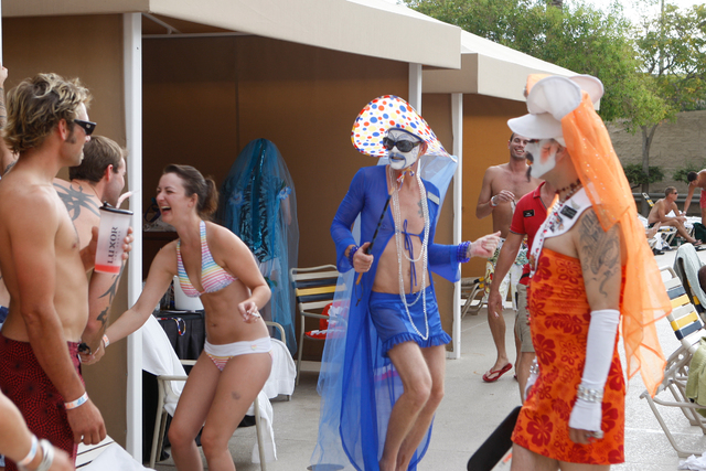 Pool-goers with Mother Loosy Lust Bea Lady, in blue, and Sister Gloria Areola Roll You Over Gluttony, in orange, who are members of the Sin Sity Sisters of Perpetual Indulgence, take part in the S ...