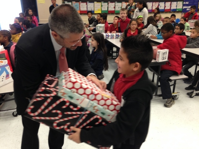 Team members from Palace Station, 2411 W. Sahara Ave., dropped off presents for 100 students at Bell Elementary School, 2900 Wilmington Way, Dec. 16. The students who received gifts were selected  ...