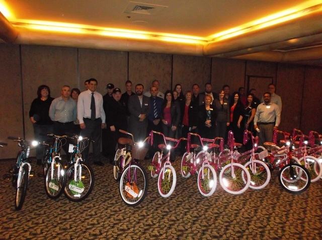 Executives and management from the Fiesta Henderson, 777 W. Lake Mead Parkway, surprised students from its Smart Start partner school, Sewell Elementary, 700 E. Lake Mead Drive, with bikes and hel ...