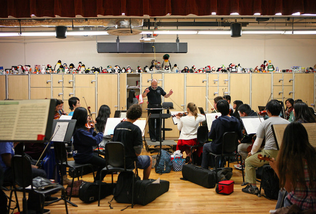 Chuck Cushinery, center, directs an orchestra class at Clark High School Friday, Dec. 12, 2014, in Las Vegas. Cushinery, who is in his 18th year teaching at Clark, is one of 10 finalists nationwid ...