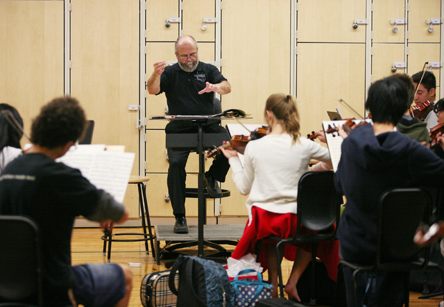 Chuck Cushinery directs an orchestra class at Clark High School Friday, Dec. 12, 2014, in Las Vegas. Cushinery, who is in his 18th year teaching at Clark, is one of 10 finalists nationwide for the ...