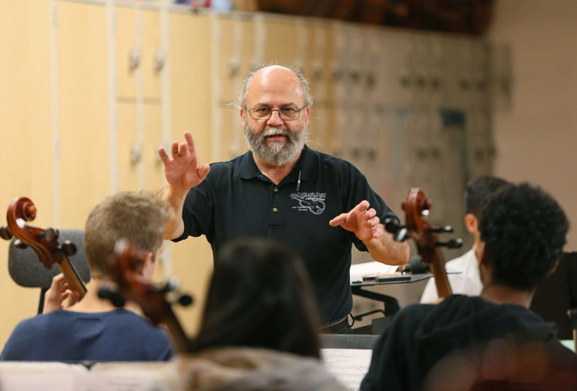 Chuck Cushinery works through a difficult section of music with students during an orchestra class at Clark High School Friday, Dec. 12, 2014, in Las Vegas. Cushinery, who is in his 18th year teac ...
