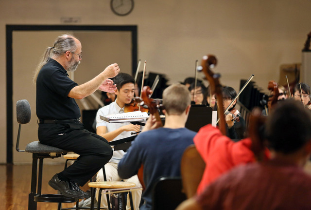Chuck Cushinery, left, directs an orchestra class at Clark High School Friday, Dec. 12, 2014, in Las Vegas. Cushinery, who is in his 18th year teaching at Clark, is one of 10 finalists nationwide  ...