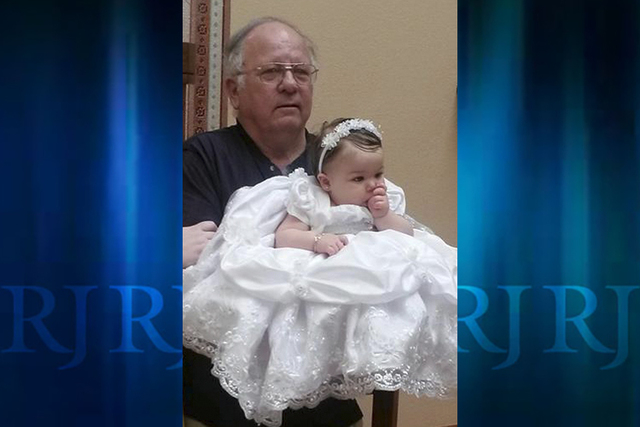 Michael Grubbs holding granddaughter Brooke in an undated photo. (Courtesy of the family)