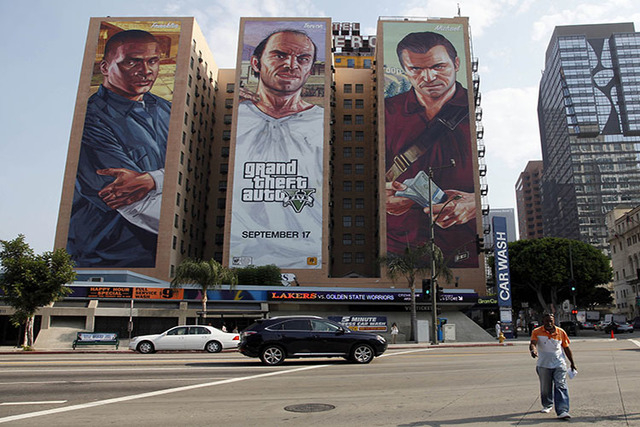 "This Sept. 10, 2013 file photo shows the ""Grand Theft Auto V "" billboard at Figueroa Hotel in Los Angeles. (AP Photo/Nick Ut)"