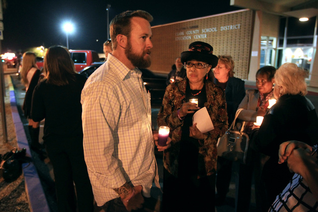 Jason Lamberth talks to Clark County School District trustee Linda Young during a candlelight vigil for his daughter Hailee Lamberth Thursday, Dec. 11, 2014. Hailee committed suicide a year earlie ...
