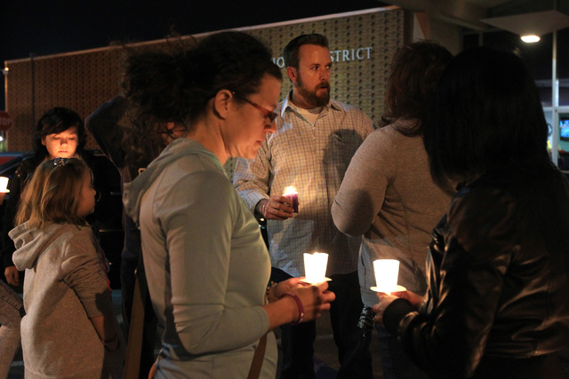 Jason Lamberth talks to supporters during a candlelight vigil for his daughter Hailee Lamberth Thursday, Dec. 11, 2014. Hailee committed suicide a year earlier as a result of being bullied. (Sam M ...