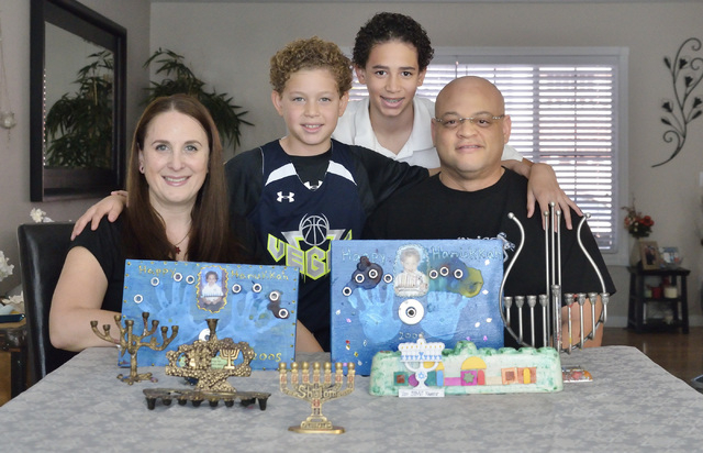 The Sims family, from left, Davida, Cole, Miles and Damon are shown with some Hanukkah-related holiday decorations at their home near West Lake Mead Boulevard and Harbor Island Drive in Las Vegas  ...