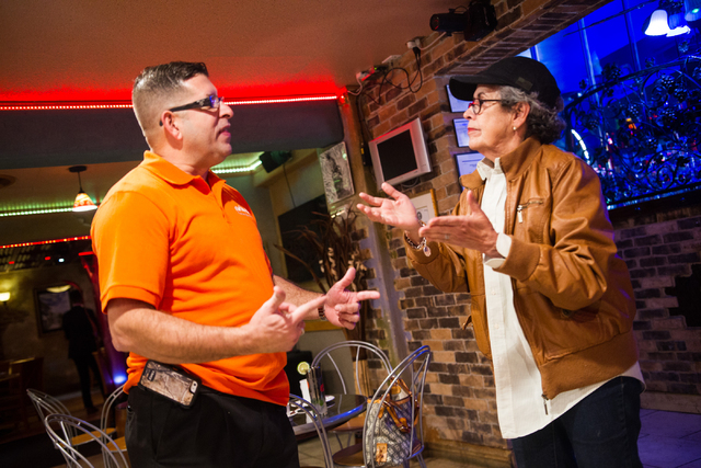 Restaurant owner Sergio Perez, left, talks with Aleyda Hernandez, owner of Aroma Cigars, about the United States and Cuba normalizing diplomatic relations, at Florida Cafe Cuban Bar & Grill, 1401  ...