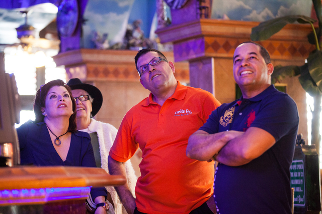 Restaurant patrons and staff, from left, Oxandra Betancourt, Angela Hernandez, Sergio Perez and Alexis Martinez watch news reports that the United States and Cuba will normalize diplomatic relatio ...