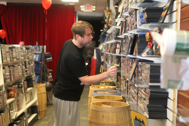 Trevor Layne, owner of Movies & Candy, 10895 S. Eastern Ave., organizes movies at his shop in Henderson Tuesday, Dec. 9, 2014. The movie rental and candy shop opened two years ago and has expanded ...