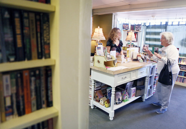 Shereen Hale, center, owner of the Book Boutique, assists customer Vivian Lasagna at the specialty shop Tuesday, Jan. 14, 2014, in Henderson. Book Boutique, which is located at 19 W. Pacific Ave., ...