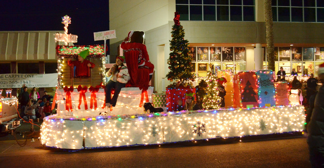 A North Pole float glides down Water Street in the Henderson WinterFest evening parade, Dec. 14, 2013.  This year's parade is scheduled for 5 p.m. Dec. 13. (Ginger Meurer/Las Vegas Review-Journal)