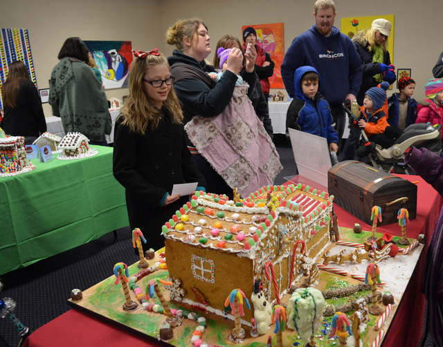 Visitors check out the WinterFest gingerbread house display inside the Henderson Convention Center, Dec. 14, 2013. (Ginger Meurer/Las Vegas Review-Journal)