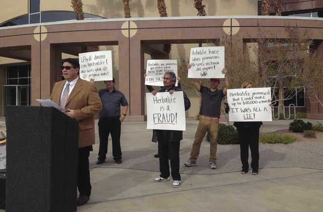Jose Melendrez, left, president of Nevada Alliance for Latino Education and Justice, speaks Thursday outside the Grant Sawyer State Building in Las Vegas as he and others call for a state investig ...