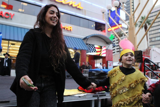 Gili Ben Harush, left, dances with Aaron Kellman, 8, during the annual Grand Menorah Lighting Ceremony at Fremont Street Experience in Las Vegas Tuesday, Dec. 16, 2014. The event was hosted by the ...