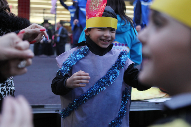 David Karoudo, 7, dances during the annual Grand Menorah Lighting Ceremony at Fremont Street Experience in Las Vegas Tuesday, Dec. 16, 2014. The event was hosted by the Chabad of Southern Nevada a ...