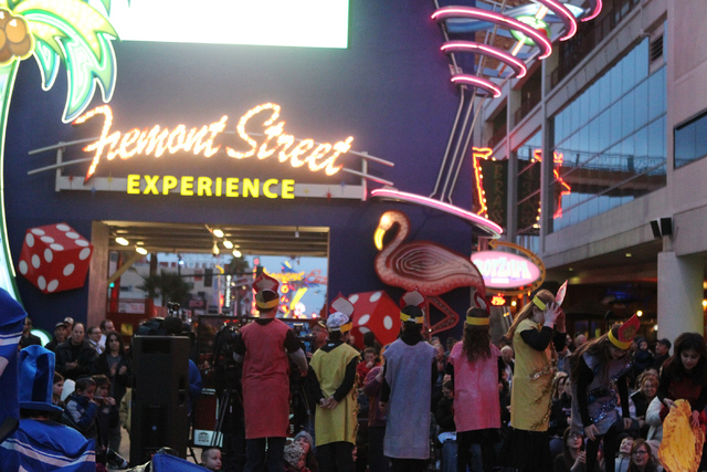 Children with the Desert Torah Academy choir perform during the annual Grand Menorah Lighting Ceremony at Fremont Street Experience in Las Vegas Tuesday, Dec. 16, 2014. The event was hosted by the ...