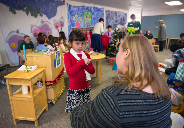 """Cevan (cq) Louie talks with middle and high school teacher Lisa Knutsen (cq) during rehearsals for the Montessori Visions Academy production of """"How the Grinch Stole Christmas!"""" at the s ..."""