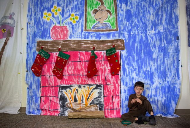 """Alexander Toca (cq) waits to start rehearsals for the Montessori Visions Academy production of """"How the Grinch Stole Christmas!"""" at the school, located at 2560 N. Green Valley Parkway in ..."""