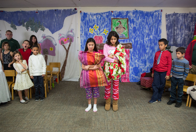 """Mary Bacay (cq), center left, and Alia Yiskis (cq), center right, rehearse for the Montessori Visions Academy production of """"How the Grinch Stole Christmas!"""" at the school, located at 25 ..."""