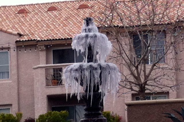 Water in a fountain at the Sahara West Apartments, 2301 Redwood St., was frozen Wednesday morning. (Cassandra Keenan/Las Vegas Review-Journal)