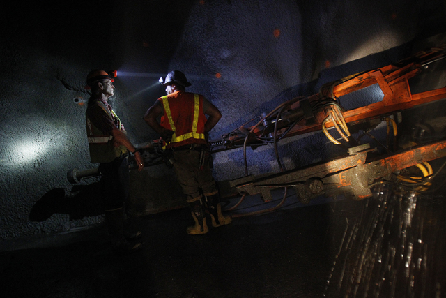 Workers work in a tunnel roughly 400 feet below ground at Lake Mead near Las Vegas Wednesday, June. 12, 2013. The Southern Nevada Water Authority will use the tunnel to link a third intake, still  ...