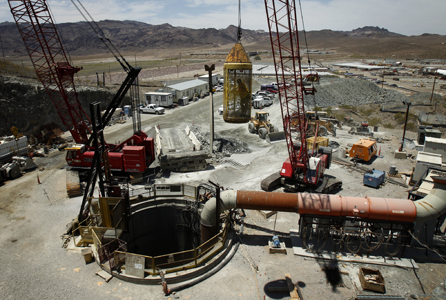 A worker is raised from a tunnel system at Lake Mead near Las Vegas Wednesday, June. 12, 2013. The Southern Nevada Water Authority will use the tunnel to link a third intake, still under construct ...