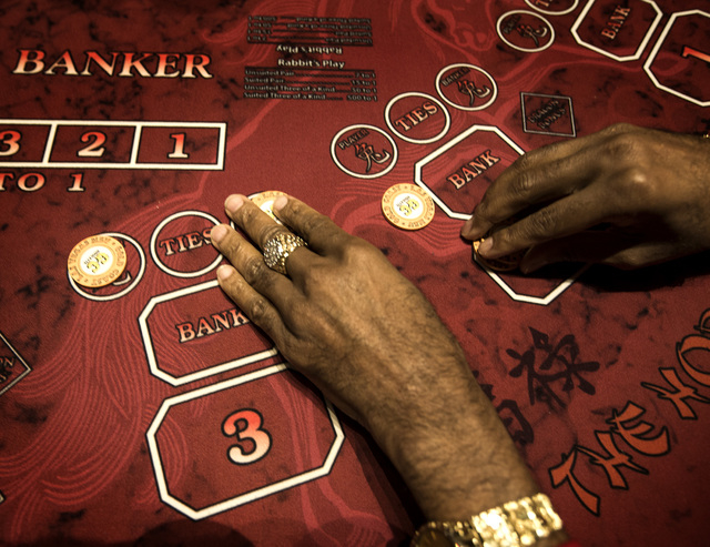 Former UNLV men's basketball star Bobby Florence places chips on a Rabbit's Play table Monday, Dec. 15, 2014 in the Gold Coast hotel-casino. Florence has developed a new baccarat game which provid ...