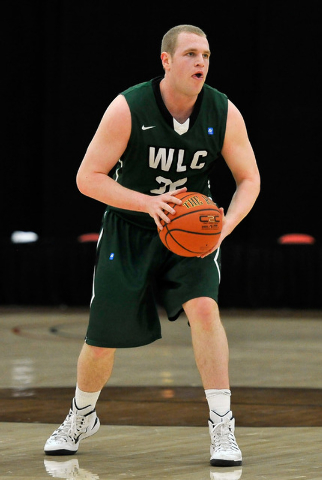 Wisconsin Lutheran forward Brett Lubbe looks to pass the ball during his division III college basketball game against Wartburg College at the South Point Arena on Tuesday, Dec. 30, 2014, in Las Ve ...