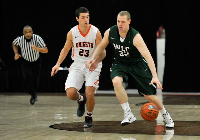 Wisconsin Lutheran forward Brett Lubbe (32) bring the ball down court against Wartburg's Nick Webber during a division III college basketball game at the South Point Arena on Tuesday, Dec. 30, 201 ...