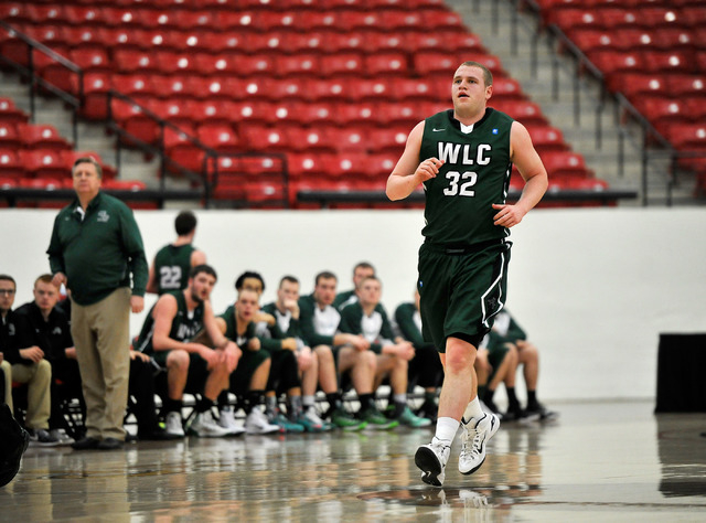 Wisconsin Lutheran forward Brett Lubbe, (32) runs up court during his division III college basketball game against Wartburg College at the South Point Arena on Tuesday, Dec. 30, 2014, in Las Vegas ...